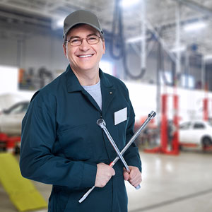 an auto mechanic with a wheel wrench